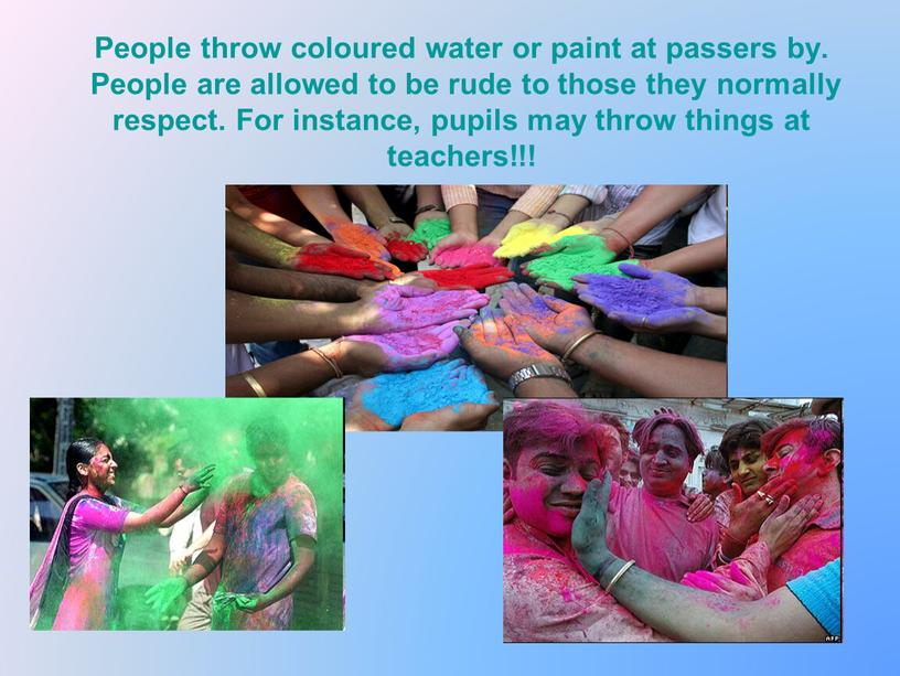 People throw coloured water or paint at passers by